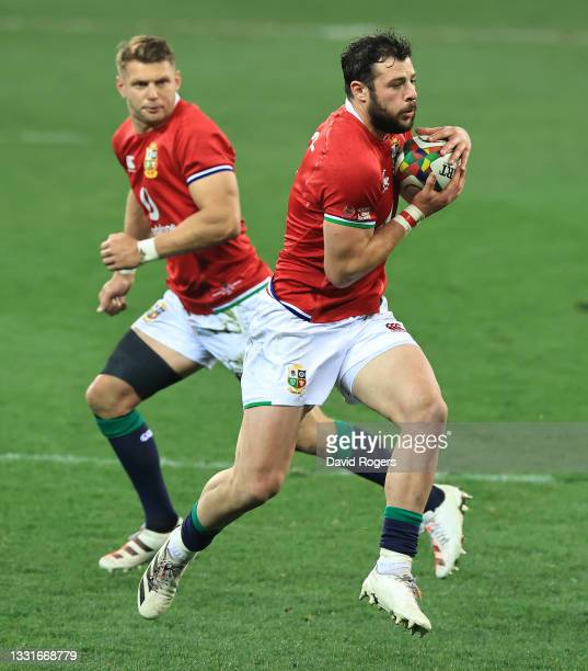 Robbie Henshaw of the Lions runs with the ball during the 2nd test match between South Africa Springboks and the British & Irish Lions at Cape Town...