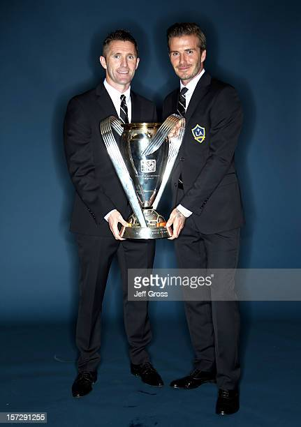 Robbie Keane and David Beckham of the Los Angeles Galaxy pose after winning the 2012 MLS Cup 3-1 against the Houston Dynamo at The Home Depot Center...