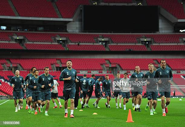 Robbie Keane and John O'Shea of Republic of Ireland lead the warmup during training ahead of their international friendly against England at Wembley...