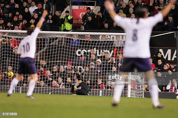 Robbie Keane and Pedro Mendes of Tottenham Hotspur appeal for a goal after the ball appeared to cross the line during the Barclays Premiership match...