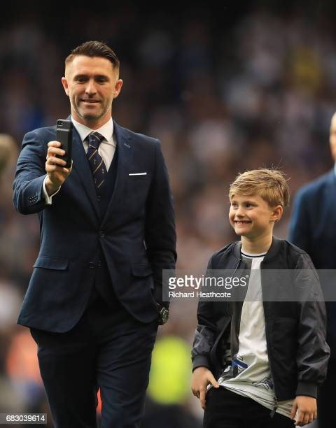 Robbie Keane ex Tottenham Hotspur player takes a selfie photograph with his son during the closing ceremony after the Premier League match between...