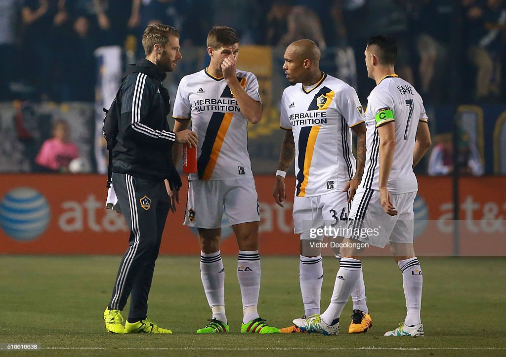 Robbie Keane #7, Nigel de Jong #34 and a trainer of the Los Angeles Galaxy talks with Steven Gerrard #8 after Gerrard injured himself early in the the first half of their MLS match against the San Jose Earthquakes at StubHub Center on March 19, 2016 in Carson, California. Gerrard left the match after 3:01 of playing time.