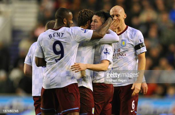 Robbie Keane of Aston Villa celebrates scoring to make it 32 Darren Bent and team mates during the Barclays Premier League match between...