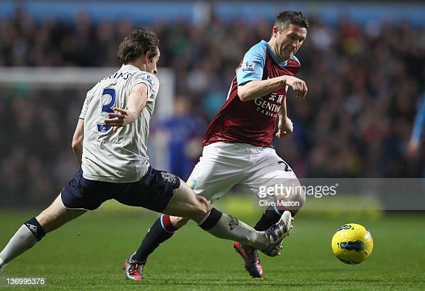 Robbie Keane of Aston Villa goes past Leighton Baines of Everton during the Barclays Premier League match between Aston Villa and Everton at Villa...