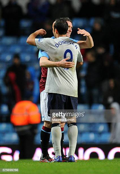Robbie Keane of Aston Villa greets Landon Donovan of Everton at the end of the game who are both on loan from LA Galaxy to the Premier League