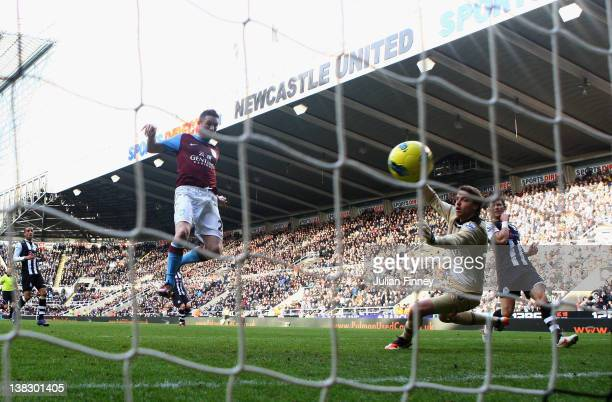 Robbie Keane of Aston Villa scores his teams first goal past Tim Krul of Newcastle during the Barclays Premier League match between Newcastle United...