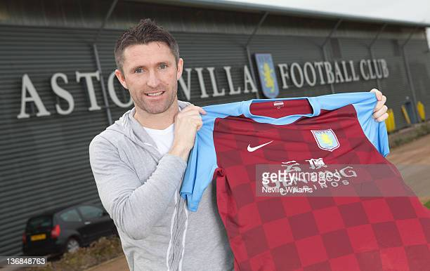 Robbie Keane of LA Galaxy poses as he signs on loan for Aston Villa at the Aston Villa training ground Bodymoor Heath on January 12, 2012 in...