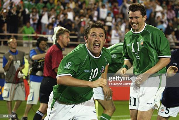 Robbie Keane of Ireland celebrates after scoring the equalising goalf during the Group E match of the World Cup Group Stage against Germany played at...