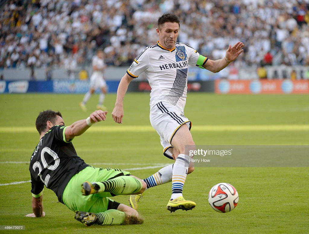 Robbie Keane #7 of Los Angeles Galaxy and Zach Scott #20 of Seattle Sounders FC chase after the ball during the Western Conference Final at StubHub Center on November 23, 2014 in Los Angeles, California.