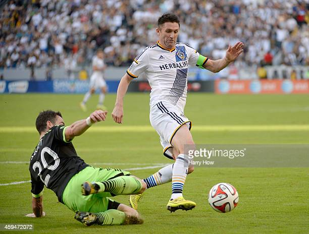 Robbie Keane of Los Angeles Galaxy and Zach Scott of Seattle Sounders FC chase after the ball during the Western Conference Final at StubHub Center...