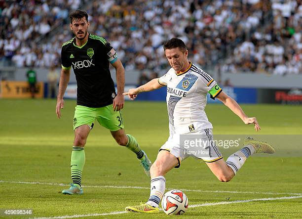 Robbie Keane of Los Angeles Galaxy attempts a shot in front of Brad Evans of Seattle Sounders FC during the Western Conference Final at StubHub...
