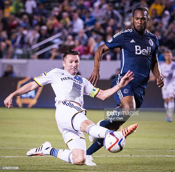 Robbie Keane of Los Angeles Galaxy attempts to volley a cross as Kendall Waston of Vancouver FC defends during the MLS match at the StubHub Center on...