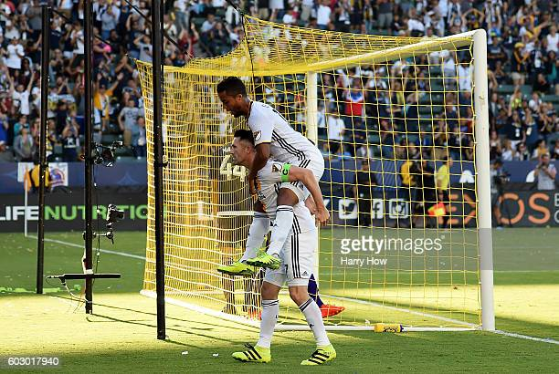 Robbie Keane of Los Angeles Galaxy celebrates his goal with Giovani dos Santos to take a 41 lead over the Orlando City FC at StubHub Center on...