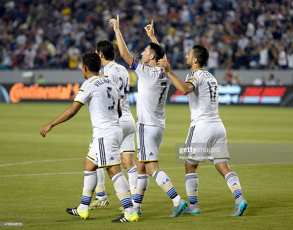 Robbie Keane #7 of Los Angeles Galaxy celebrates his hat-trick with teammates after scoring his third goal of the game against Toronto FC on July 4, 2015 at StubHub Center in Carson, California.