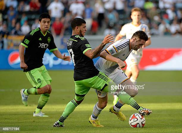 Robbie Keane of Los Angeles Galaxy is fouled by Deindre Yedlin of Seattle Sounders FC during the Western Conference Final at StubHub Center on...