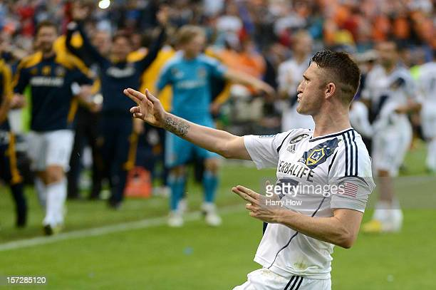 Robbie Keane of Los Angeles Galaxy reacts after scoring on a penalty kick in the second half against the Houston Dynamo in the 2012 MLS Cup at The...