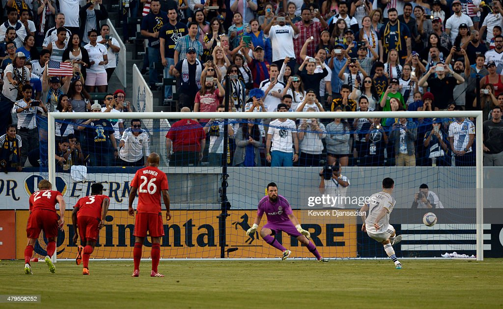 Robbie Keane #7 of Los Angeles Galaxy scores on a penalty kick against Toronto FC on July 4, 2015 at StubHub Center in Carson, California.
