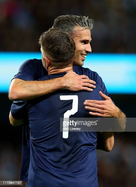 Robbie Keane of Premier League AllStars XI is congratulated by team mate Robin Van Persie after scoring a goal during the Vincent Kompany testimonial...