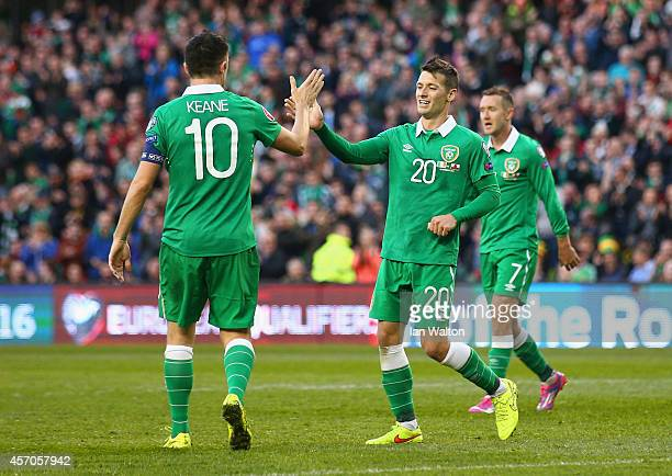 Robbie Keane of Republic of Ireland congratulates Wes Hoolahan of Republic of Ireland on scoring their seventh goal during the EURO 2016 Qualifier...