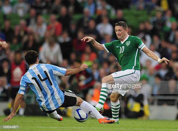 Robbie Keane of Republic of Ireland is tackled by Javier Mascherano of Argentina during the International Friendly match between Republic of Ireland...
