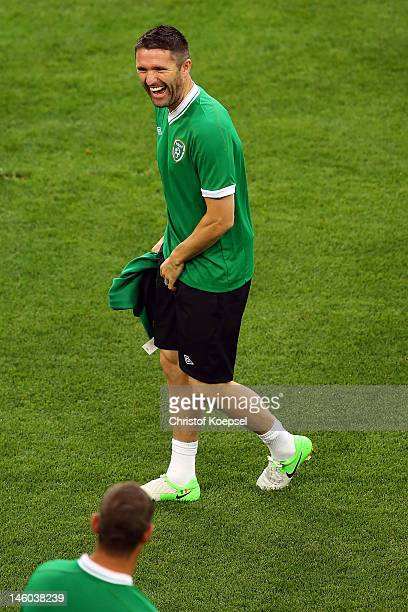 Robbie Keane of Republic of Ireland laughs during a Republic of Ireland training session prior to the UEFA EURO 2012 Group C match against Croatia at...