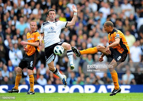 Robbie Keane of Spurs and Karl Henry of Wolves compete for the ball during the Barclays Premier League match between Tottenham Hotspur and...