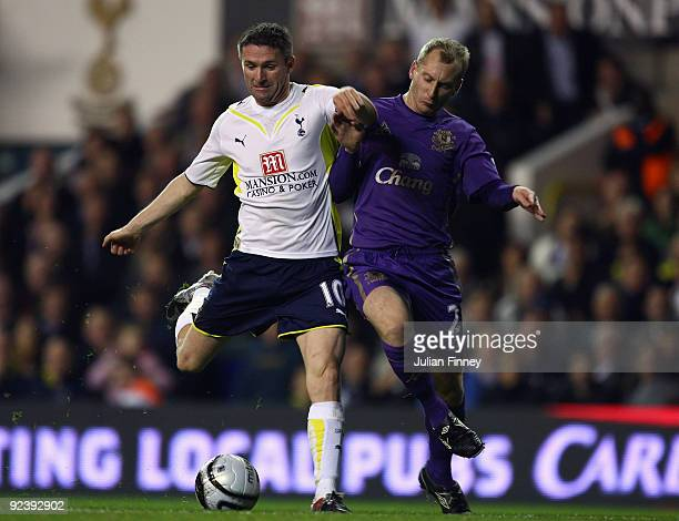 Robbie Keane of Spurs battles with Tony Hibbert of Everton during the Carling Cup 4th Round match between Tottenham Hotspur and Everton at White Hart...