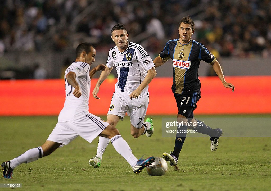 Robbie Keane #7 of the Los Angeles Galaxy and Michael Farfan #21 of the Philadelphia Union pursue the ball controlled by Juninho #19 of the Los Angeles Galaxy during the MLS match at The Home Depot Center on July 4, 2012 in Carson, California. The Union defeated the Galaxy 2-1.
