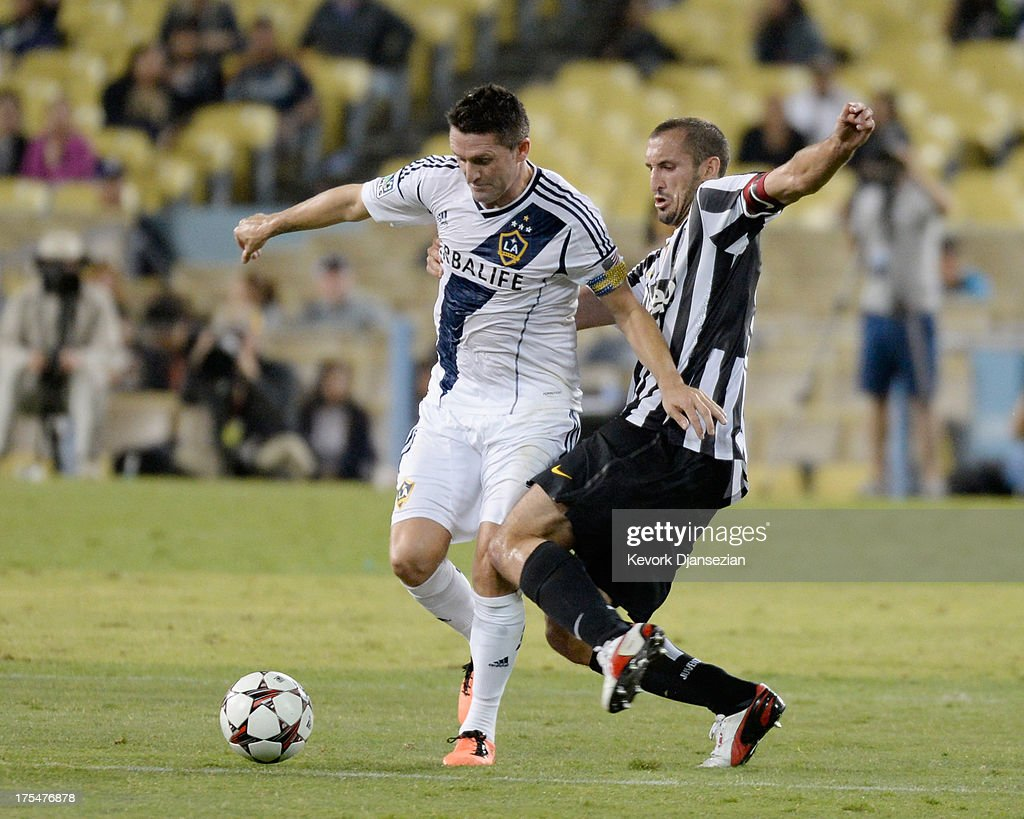 Robbie Keane #7 of the Los Angeles Galaxy battles for the ball with Girogio Chiellini #3 of Juventus during the first half of the 2013 Guinness International Champions Cup at Dodger Stadium on August 3, 2013 in Los Angeles, California