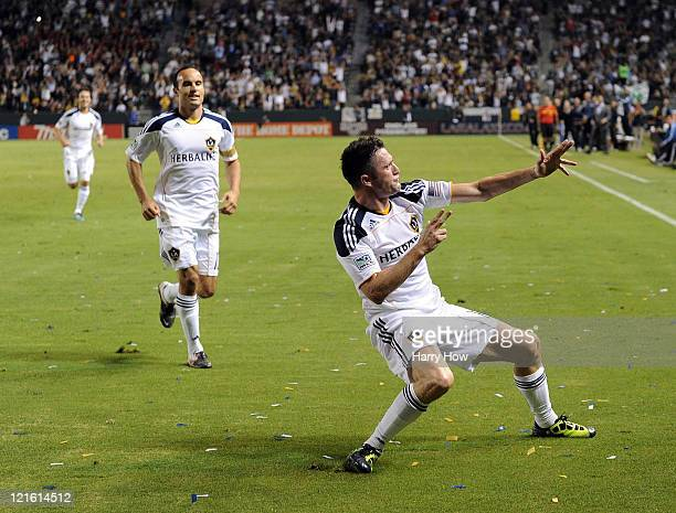 Robbie Keane of the Los Angeles Galaxy celebrates his goal in his debut game for a 10 lead over the San Jose Earthquakes as Landon Donovan looks on...