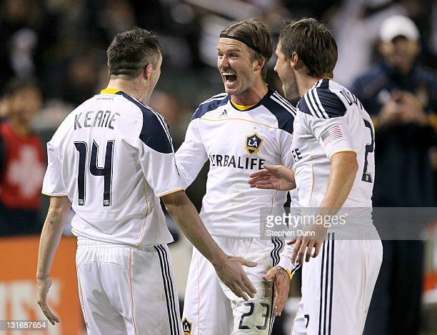 Robbie Keane of the Los Angeles Galaxy celebrates with David Beckham and Todd Dunivant after Keane scored the Galaxy's third goal against Real Salt...