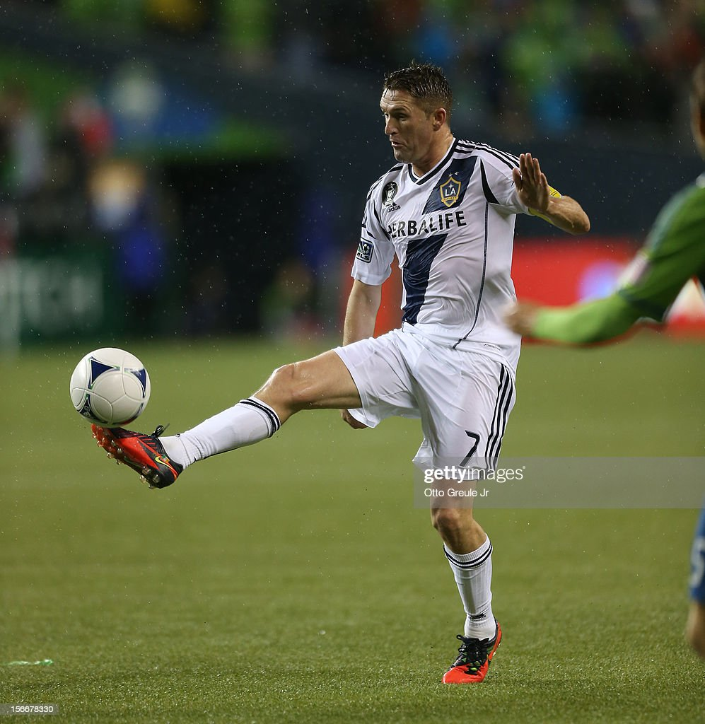 Robbie Keane #7 of the Los Angeles Galaxy dribbles against the Seattle Sounders FC during Leg 2 of the Western Conference Championship at CenturyLink Field on November 18, 2012 in Seattle, Washington. The Galaxy defeated the Sounders 2-1, winning the aggregate playoff 4-2.