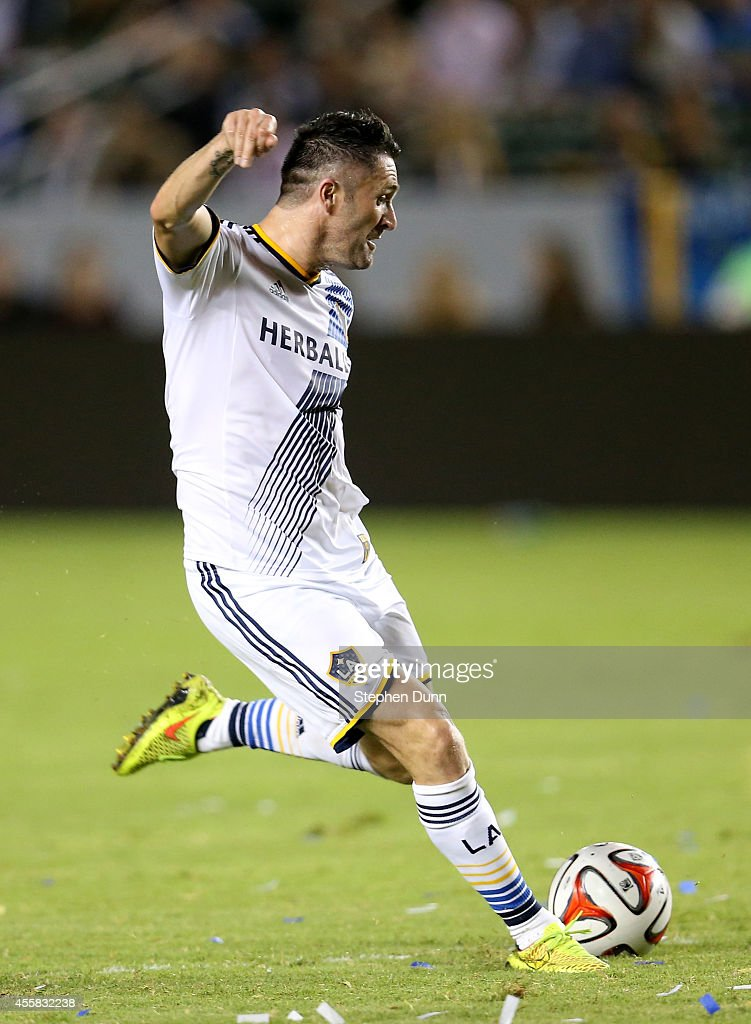 Robbie Keane #7 of the Los Angeles Galaxy takes a shot at the FC Dallas goal at StubHub Center on September 20, 2014 in Los Angeles, California.