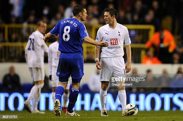 Robbie Keane of Tottenham and Frank Lampard of Chelsea exchange words during the Barclays Premier League match between Tottenham Hotspur and Chelsea...