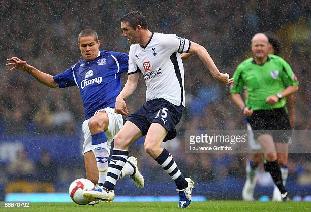 Robbie Keane of Tottenham battles with Jack Rodwell of Everton during the Barclays Premier League Match between Everton and Tottenham Hotspur at...