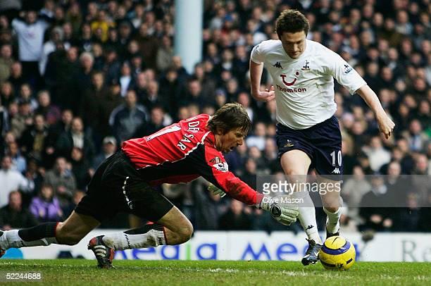 LONDON FEBRUARY 26 Robbie Keane of Tottenham goes past Edwin Van Der Sar of Fulham to score during the Barclays Premiership match between Tottenham...