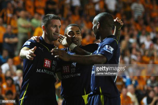 Robbie Keane of Tottenham Hotspur celebrates his goal with Aaron Lennon and Jermain Defoe during the Barclays Premier League match between Hull City...