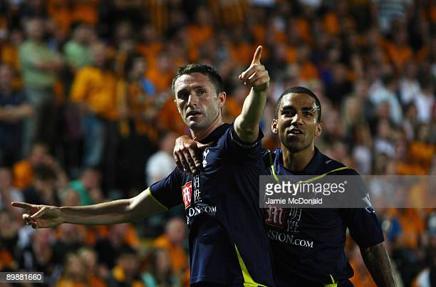 Robbie Keane of Tottenham Hotspur celebrates his goal with Aaron Lennon during the Barclays Premier League match between Hull City and Tottenham...