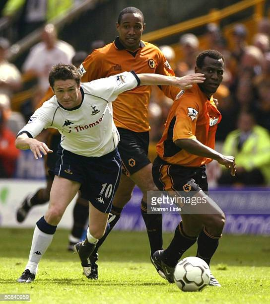 Robbie Keane of Tottenham Hotspur evades a tackle during the FA Barclaycard Premiership match between Wolverhampton Wanderers and Tottenham Hotspur...