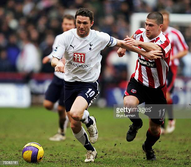 Robbie Keane of Tottenham Hotspur is challenged by Nick Montgomery of Sheffield United during the opening goal during the Barclays Premiership match...