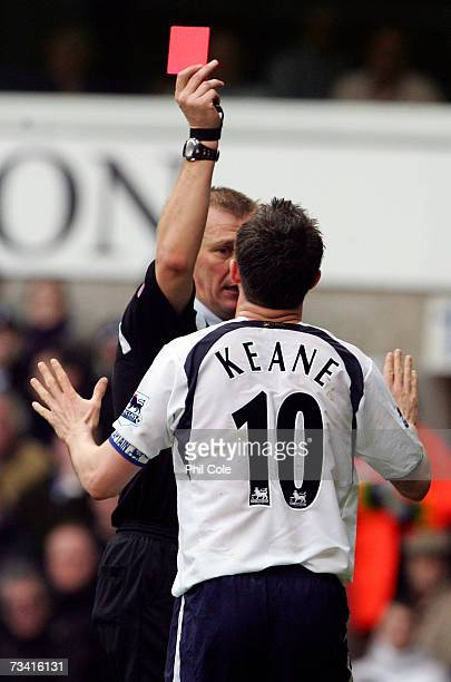 Robbie Keane of Tottenham Hotspur is shown a red card by Referee Graham Poll during the Barclays Premiership match between and Tottenham Hotspur and...