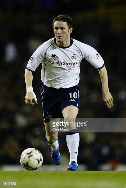 Robbie Keane of Tottenham Hotspur running with the ball during the FA Barclaycard Premiership match between Tottenham Hotspur and Manchester United...