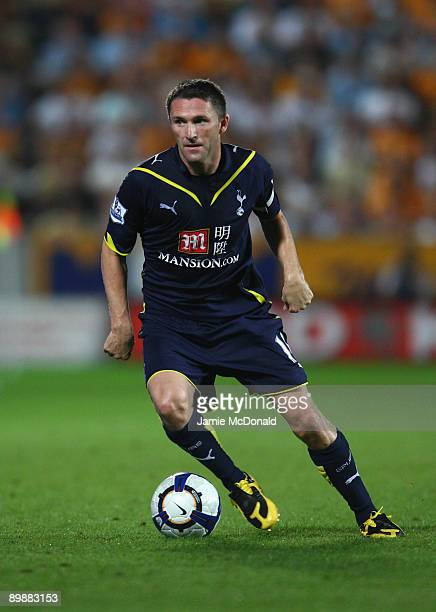 Robbie Keane of Tottenham Hotspur runs with the ball during the Barclays Premier League match between Hull City and Tottenham Hotspur at the KC...