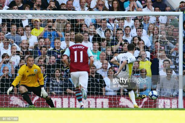 Robbie Keane of Tottenham Hotspur sends goalkeeper Brian Jensen of Burnley the wrong way to score the first goal of the match from the penalty spot...