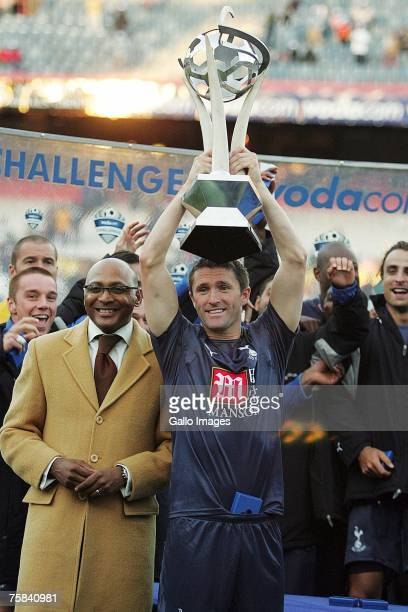 Robbie Keane of Tottenham lifts the trophy after the final Vodacom Challenge match between Orlando Pirates and Tottenham Hotspur held at Loftus...