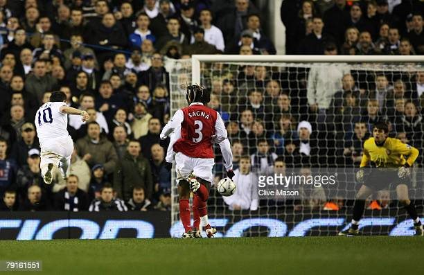 Robbie Keane of Tottenham scores his and Tottenham's third goal during the Carling Cup Semifinal second leg match between Tottenham Hotspur and...