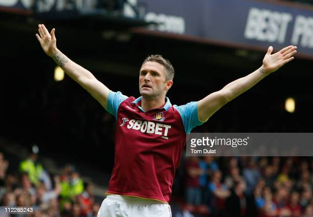 Robbie Keane of West Ham United celebrates scoring the opening goal during the Barclays Premier League match between West Ham United and Aston Villa...
