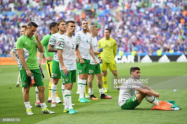 Robbie Keane, Seamus Coleman and Shane Long of Republic of Ireland show their disappointmen after defeat in the UEFA Euro 2016 match between France...