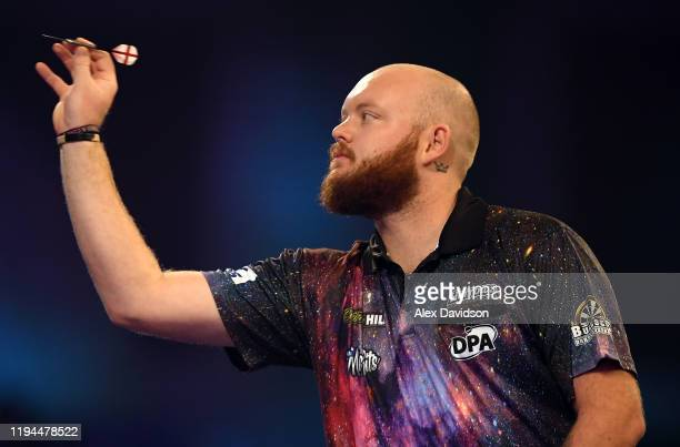 Robbie King in action during his 1st Round match against Ryan Searle during Day 5 of the 2020 William Hill Darts Championship at Alexandra Palace on...