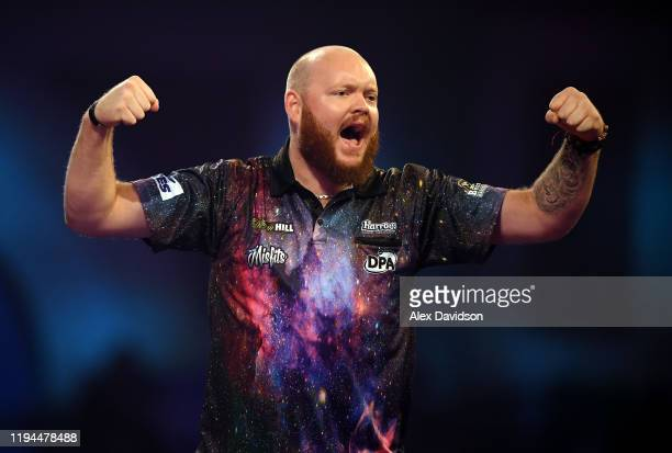 Robbie King reacts during his 1st Round match against Ryan Searle during Day 5 of the 2020 William Hill Darts Championship at Alexandra Palace on...